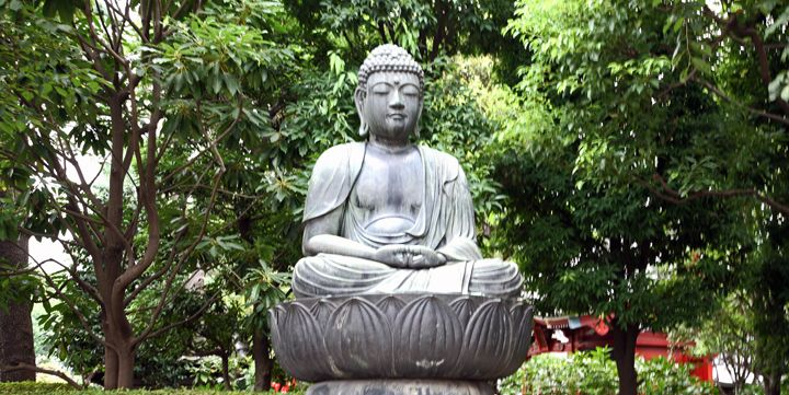 photo of statue of Buddha